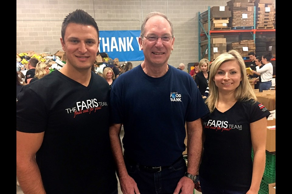 Community partners Mark and Joanna Faris are pictured with Peter Sundborg.