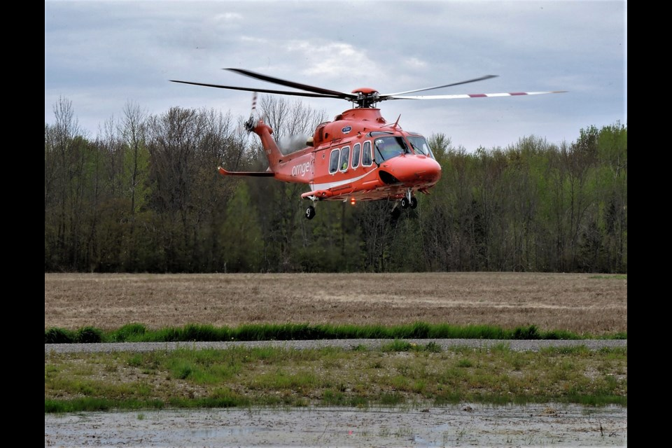 An air ambulance lands in Innisfil following a head-on collision involving two vehicles around 10:30 a.m. on May 22, 2019. Photo supplied