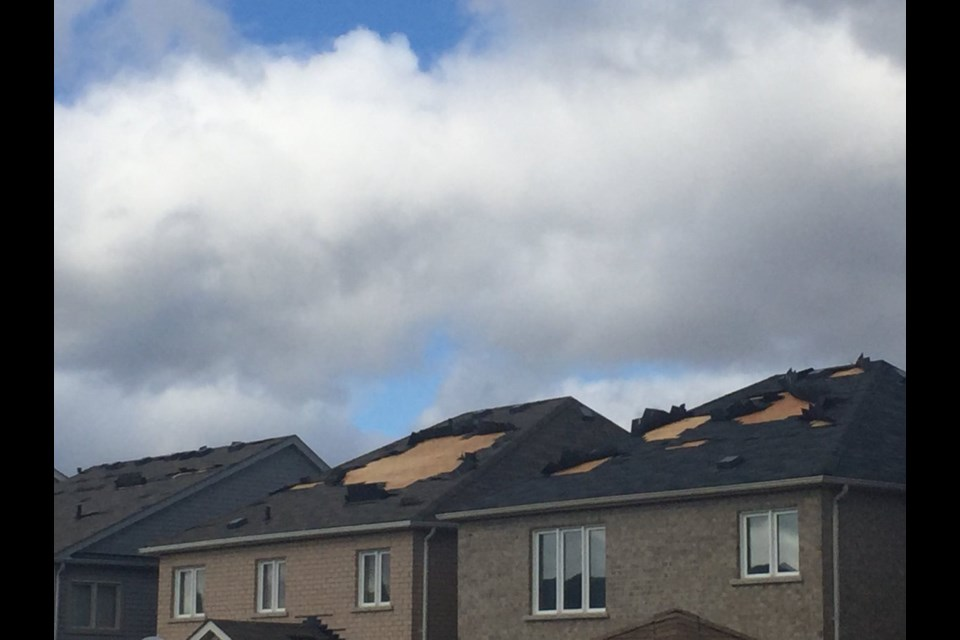 Bradford West Gwillimbury Coun. Raj Sandhu tweeted this photo of some homes on Gwillimbury Drive where shingles flew off houses in the high winds.