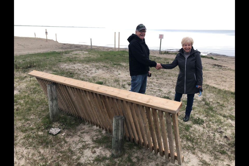 Jack Marley thanks Nancy Ludlow for finding a railing on Wasaga Beach that had been carried away from a trail in Collingwood. Erika Engel/CollingwoodToday