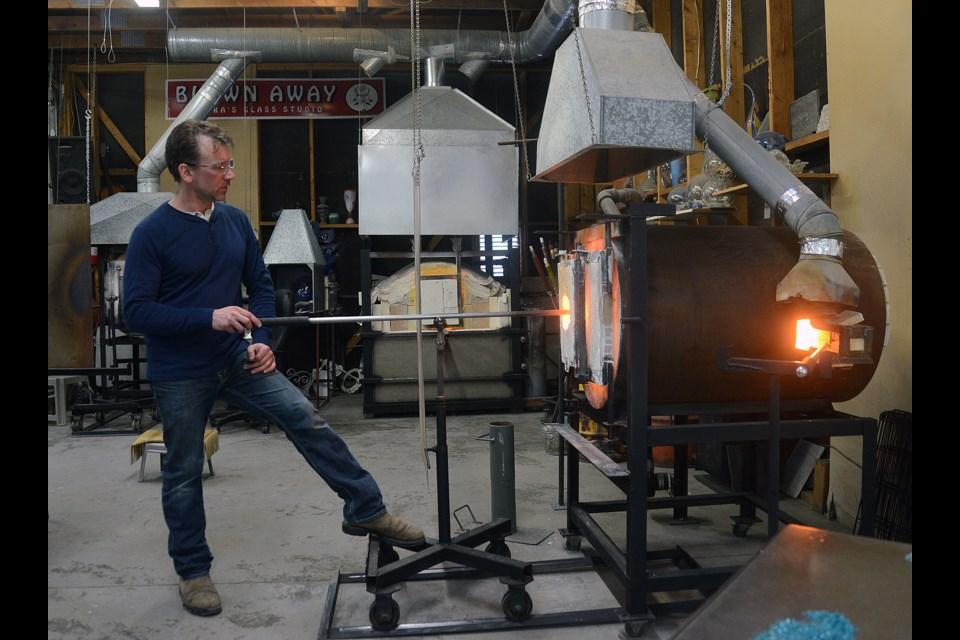 Tim McManus heats up some glass. Tony Saxon/GuelphToday