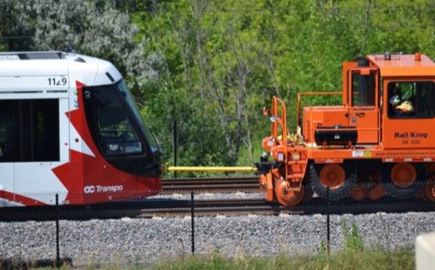2019-07-18 LRT train towed Hurdman Rail613