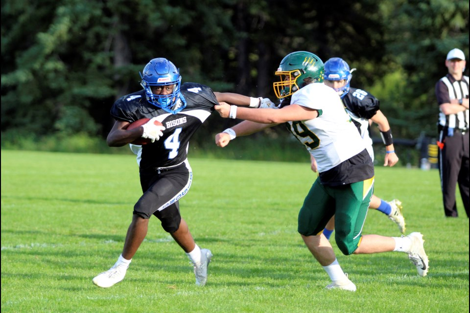 Wolverines' Colby Thompson, right, tries to tackle a Bisons player. JORDAN SMALL RMO PHOTO