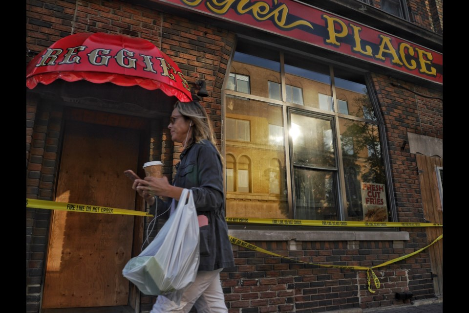 Reggie's Place Tavern remains taped off this morning after a fire on Sunday that caused the evacuation of a number of apartment residents. Michael Purvis/SooToday