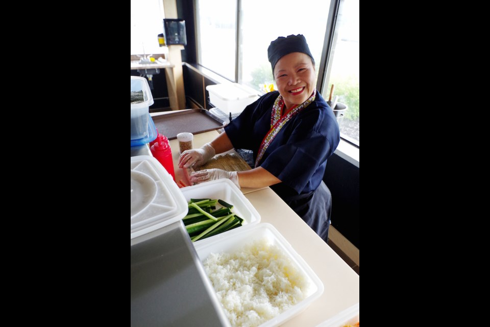 Chita Triplett prepares items for the sushi bar at Waterfront Legend. Michael Purvis/SooToday