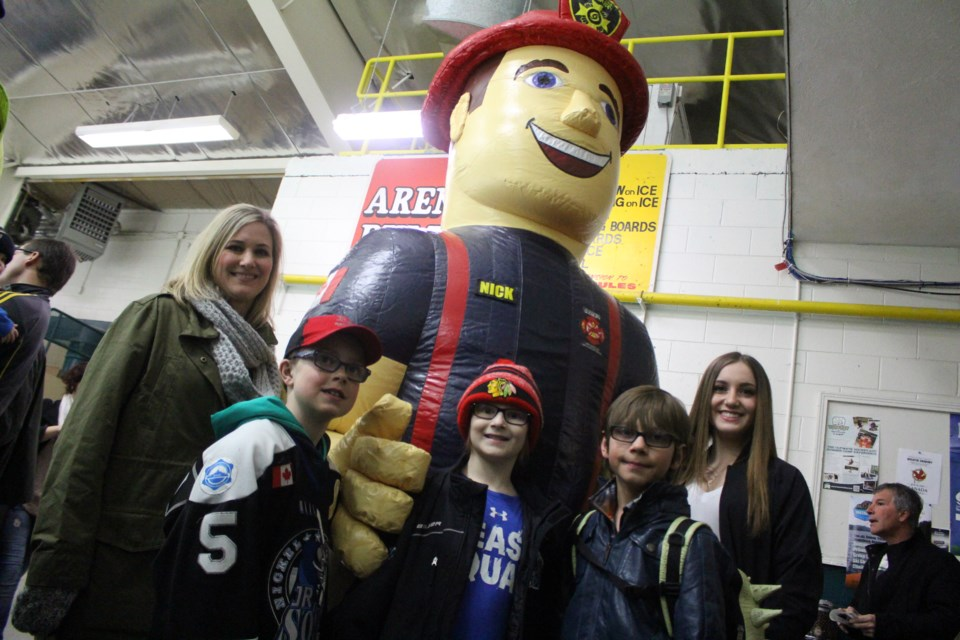 Toronto may have won the Fire Fighters' Cup with a 4-3 victory, but everyone was playing for the same cause - nine-year-old Hudson Fletcher, who is battling cancer. Pictured left to right: Hudon's mother Natalie Fletcher, friend Dominique Michaud, Hudson Fletcher, friend William Natti and Hudson's sister Dylan Fletcher. (Heather Green-Oliver)