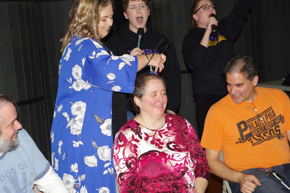 Devon Berry, a hairdresser from Magicuts, volunteered to shave all the teachers. Bob Liddycoat / Thorold News